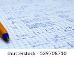 Small photo of School Notebook With Handwritten Algebra Equations