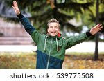 cheerful teenager in park on... | Shutterstock . vector #539775508