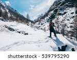 man hiking with snowshoes on... | Shutterstock . vector #539795290