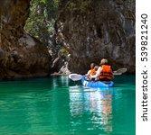Family Kayaking And Makes...