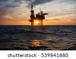 Silhouette Of Offshore Oil...
