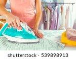 closeup of woman ironing... | Shutterstock . vector #539898913