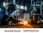 man welds at the factory | Shutterstock . vector #539932924