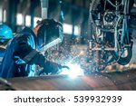 man welds at the factory | Shutterstock . vector #539932939