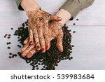 woman applies coffee scrub on... | Shutterstock . vector #539983684
