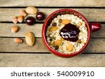 healthy muesli in deep red bowl ... | Shutterstock . vector #540009910
