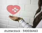 in the palm of the human heart... | Shutterstock . vector #540036463