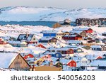 Nuuk city covered in snow with sea and mountains in the background, Greenland