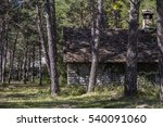 An Old Cabin Surrounded With...