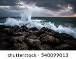 Waves Crashing On The Black...