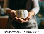 Hands Of A Ceramist Holding A...