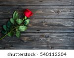 Stock photo romantic background with red rose on wood table top view 540112204