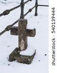 Old Cemetery Cross In Winter...