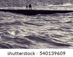 Lone Fisherman On Pier. Man...