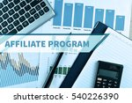 Small photo of Notebook and Laptop with graph and charts. Financial Concept with word Affiliate Program