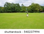 A Girl Running In The Lawn Park