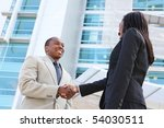 An african american business man and woman team handshake at office building - stock photo