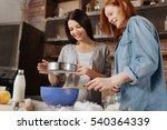 delighted smiling girls looking ... | Shutterstock . vector #540364339