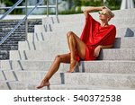 fashion woman in red dress...