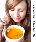 delighted woman holding a soup...