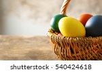 Easter Eggs In Basket On Woode...
