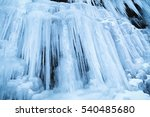 Frozen Icicles On Rocky Wall A...