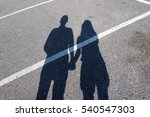 Shadow Of Couple On The Ground