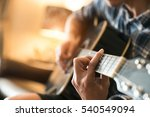 relax   play guitar in home | Shutterstock . vector #540549094