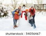 Family Building Snowman In...