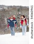 Family Having Fun In Snowy...