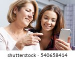 teenage daughter showing mother ... | Shutterstock . vector #540658414