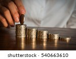 close up hand putting money... | Shutterstock . vector #540663610