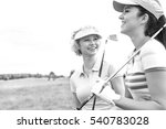 Cheerful female friends at golf ...