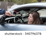 Small photo of drink and drive crashed young female driver due to being subject to test for alcohol content with use of breathalyzer. she is devastated