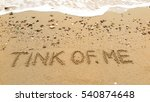 "Small photo of Handwriting words ""TINK OF ME"" on sand of beach"