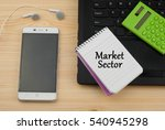 Small photo of Market sector text written on a notebook. Wooden background with laptop,phone and calculator. Business and management concept.