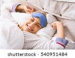joyful girl relaxing in bedroom | Shutterstock . vector #540951484