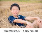Young Asian Boy Smiling In Hay...