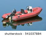 Red Inflatable Boat With Motor