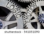 Small photo of Macro photo of tooth wheel mechanism with imprinted LOGIC, EMOTION concept words