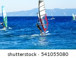 Side View Of Young Windsurfer...