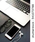 a laptop  a tablet  a earphones ... | Shutterstock . vector #541073788