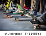 A Skateboarder In Action At...