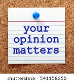 Small photo of The words Your Opinion Matters in blue text on a note card pinned to a cork notice board as a reminder of the importance of customer feedback