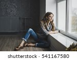 the girl in faded blue jeans... | Shutterstock . vector #541167580