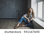 the girl in faded blue jeans... | Shutterstock . vector #541167640