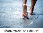 Woman Bare Foot Walking On The...