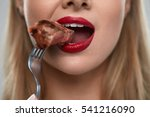 eating meat. closeup of woman... | Shutterstock . vector #541216090