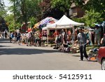OTTAWA, CANADA -MAY 29:   Thousands of people gather at the annual Glebe neighborhood garage sale which takes place for several blocks in the Glebe area of Ottawa, Ontario May 29, 2010. - stock photo