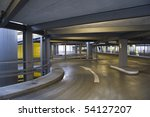 Empty circular parking garage ramp at airport - stock photo